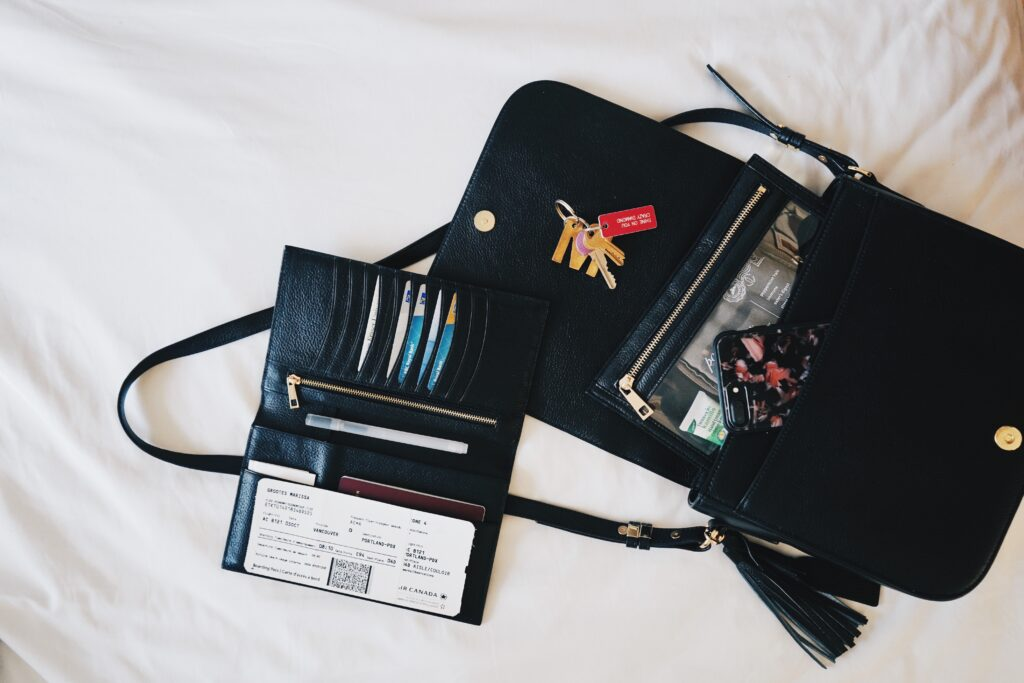 Purse with plane ticket and keys and phone