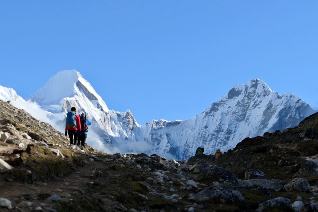 Mount Everest with two hikers