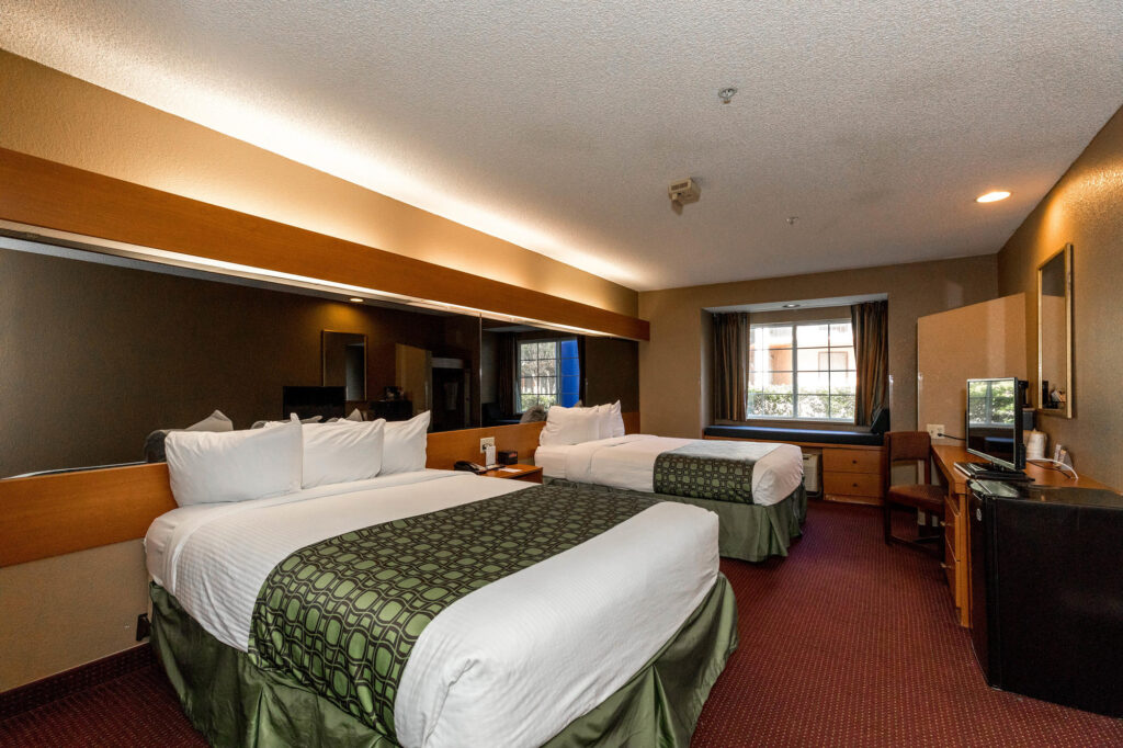 The Two Queen Beds Accessible Room at the Microtel Inn & Suites by Wyndham Tallahassee