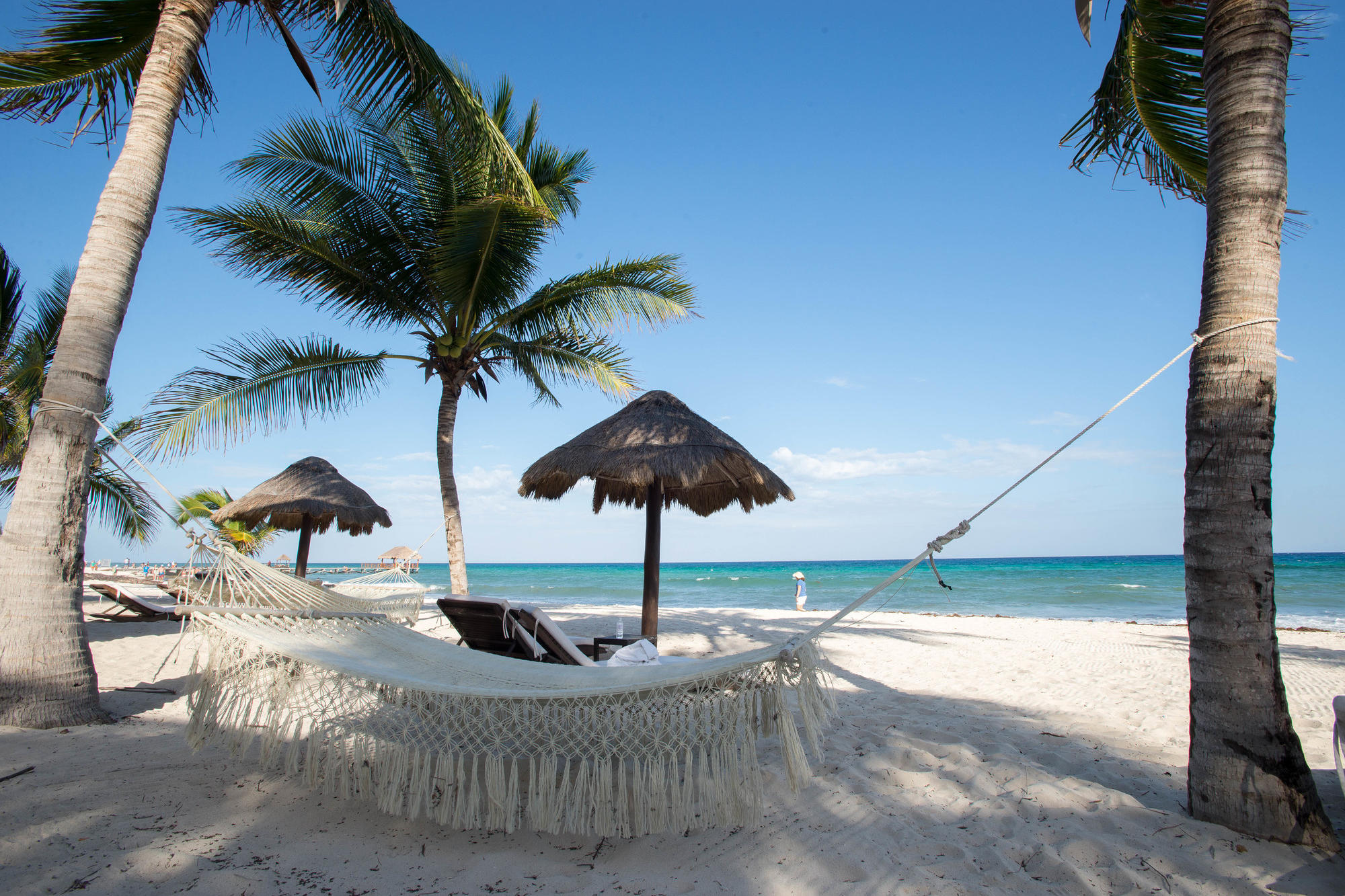 The peaceful beach with hammocks at Le Reve Boutique Beachfront Hotel