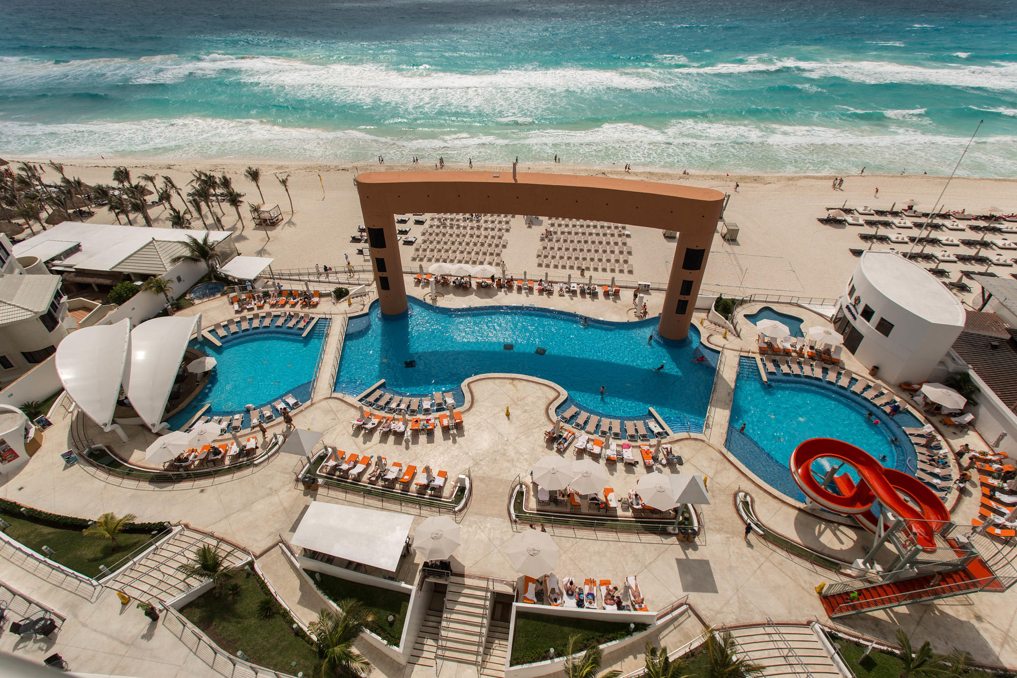 The pool and sea at the Beach Palace Cancun