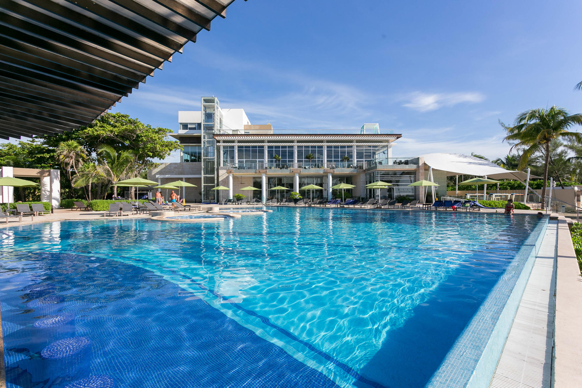 The pool and swim-up bar at The Fives Azul Beach Resort