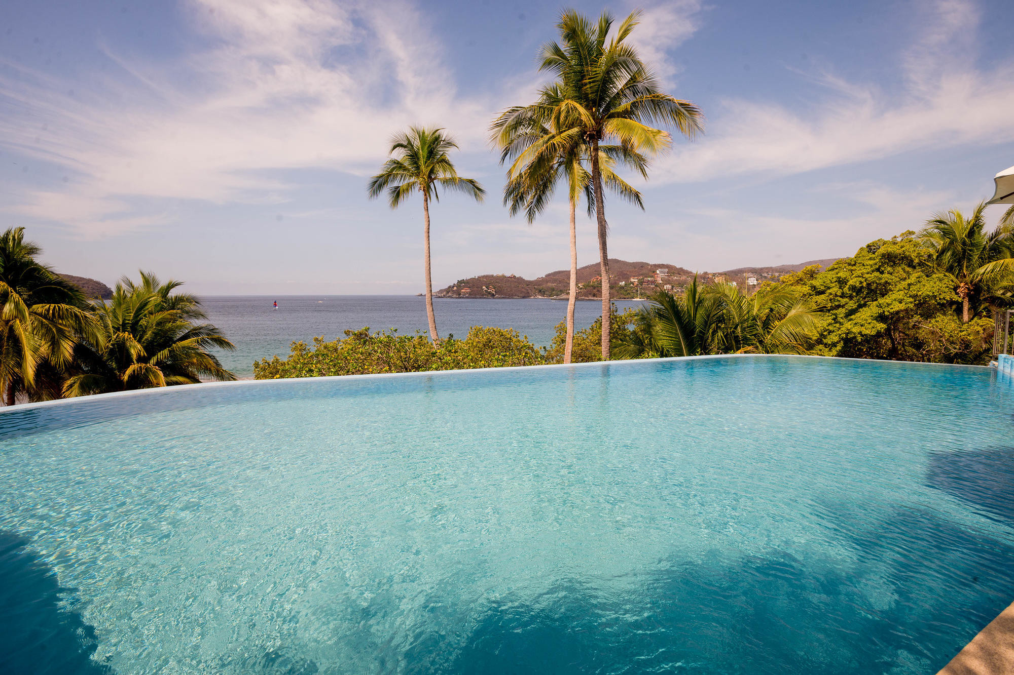 The pool and bay view at Catalina Beach Resort in Zihuatanejo/Oyster