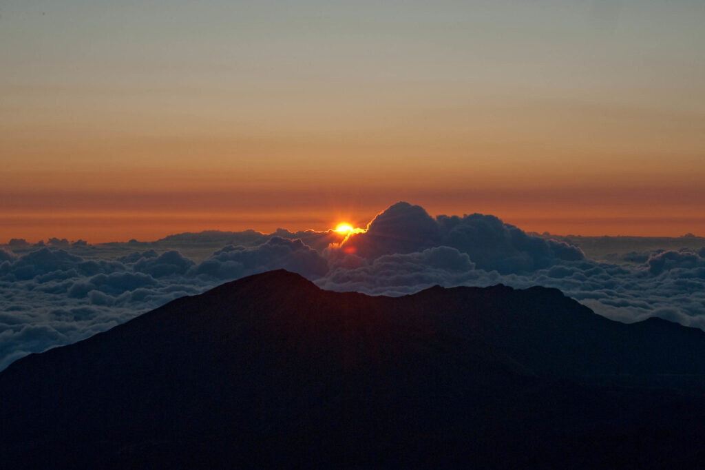 Sunset view from Maui's mountains above the clouds