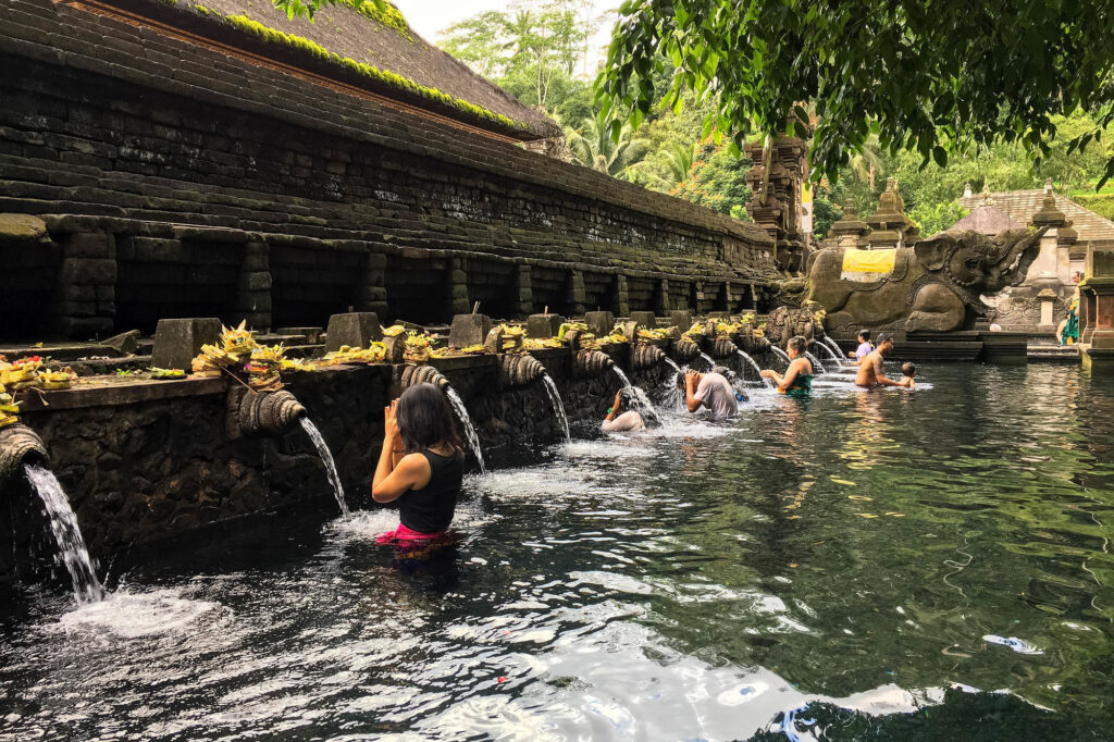 Praying bathers in the pools at Pura Tirta Empul in Bali
