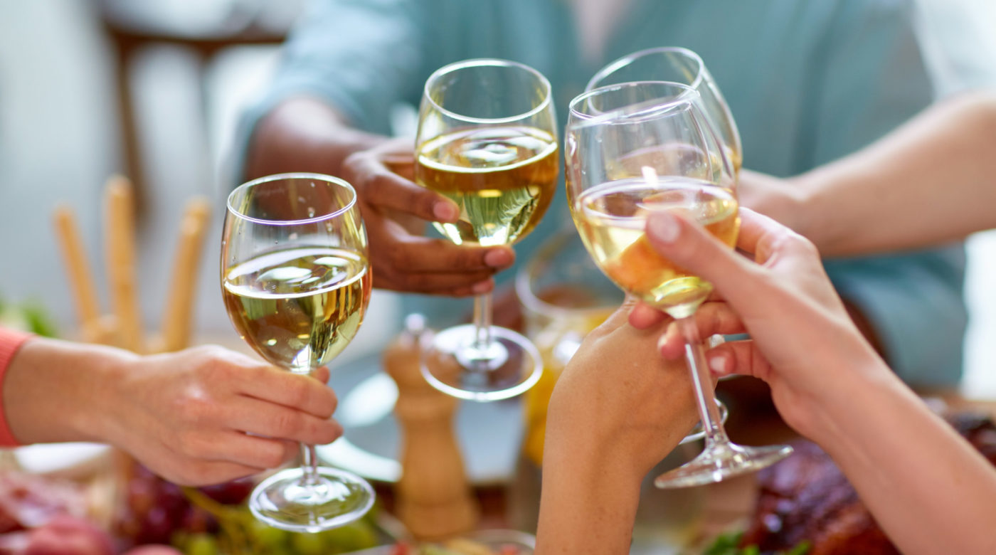 Hands toasting with wine glasses