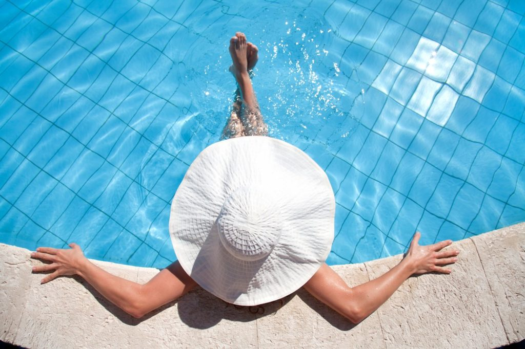 Woman relaxing in the pool at Suwannee Valley Resort