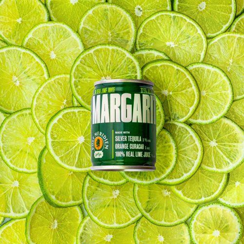 Post Meridiem Margarita on a background of limes