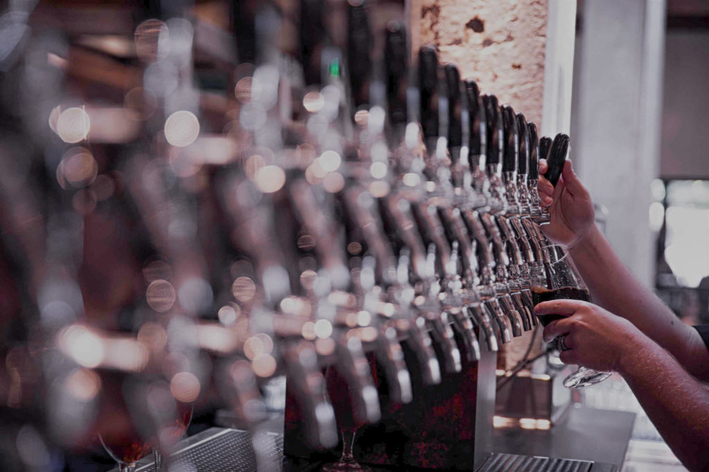 Hands pouring beer from the tap