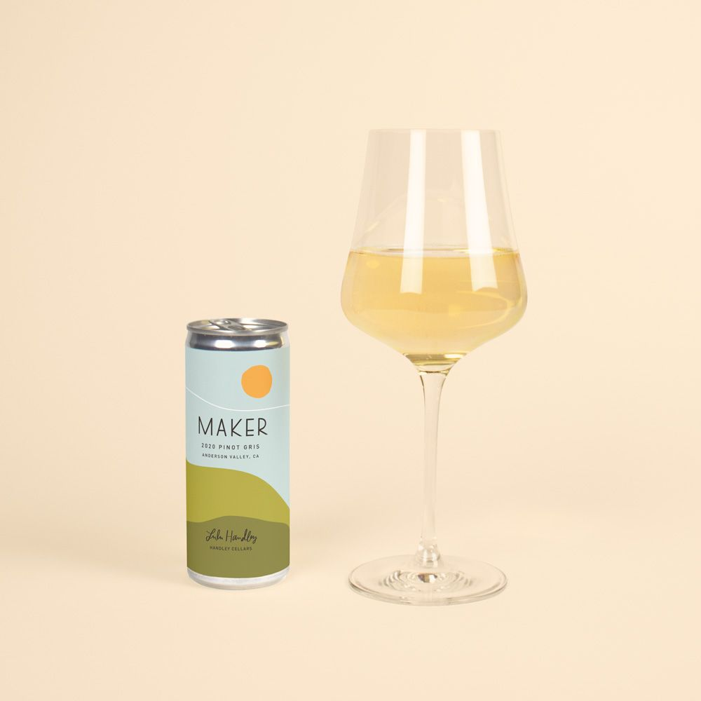 Can of Maker Pinot Gris next to a full glass of white wine