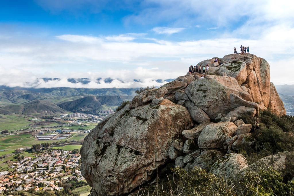 People on top of Bishop Peak in San Luis Obispo, California